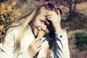 Teenage girl eating an ice cream — Stock Photo