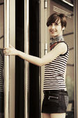 Happy young fashion woman at the mall door — Stock Photo