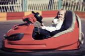 Teenage girl sitting in a bumper car — Stock Photo