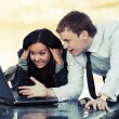 Young business couple with laptop outdoor — Stock Photo #66508573
