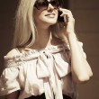 Blond fashion woman calling on the cell phone — Stock Photo #67096329