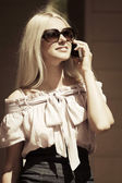 Blond fashion woman calling on the cell phone  — Stock Photo