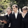 Young business people using laptop in a city park — Stock Photo #68523891