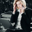 Tired businesswoman calling on the mobile phone — Stock Photo #68524107