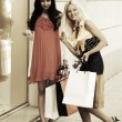 Two happy young women with shopping bags — Stock Photo #68524485