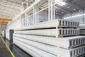 Stack of precast reinforced concrete slabs in a house-building factory workshop — Stock Photo