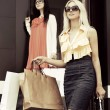 Two young women with shopping bags  — Stock Photo #71736247