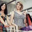 Two young fashion women with shopping cart in the mall — Stock Photo #71736299