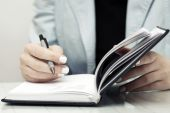 Business woman writing in notebook  — Stock Photo