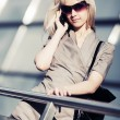 Blond fashion woman calling on the cell phone — Stock Photo #77788182