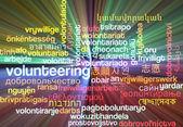 Volunteering multilanguage wordcloud background concept glowing — Stock Photo