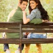 Young Smiling Couple On A Park Bench — Stock Photo #57093927