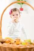 A Little Girl Eating Pastry — Stock Photo
