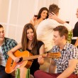 Girl Playing Guitar At House Party — Stock Photo #59215595