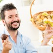 A Young Man With A Pastry — Stock Photo #59749641