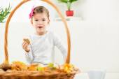 A Little Girl Eating Baked Products — Stock Photo