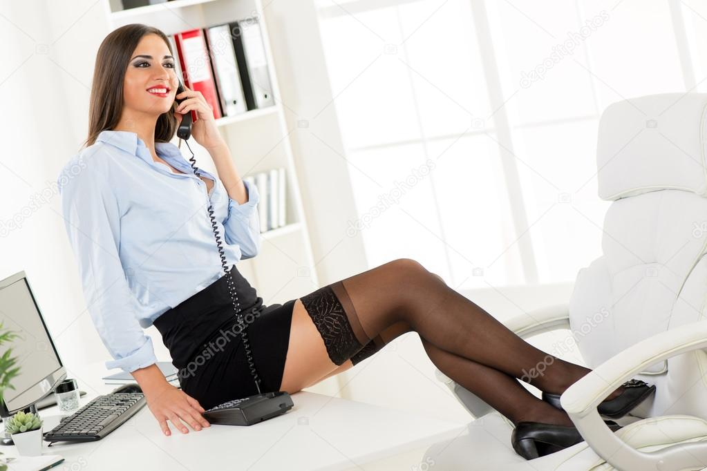 Sexy Businesswoman Phoning — Stock Photo © MilanMarkovic #60842059