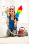 Housewife With Vacuum Cleaner And Duster — Stock Photo