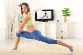 Woman Exercise In Front Of TV — Stock fotografie