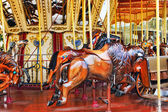 Colorful Carousel with horses — Stock Photo