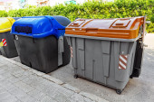 Recycling containers on street — Stock Photo
