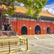 Bronze lion at the entrance to beautiful Yonghegong Lama Temple. — Stock Photo #77111057