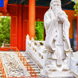 Statue of Confucius, the great Chinese philosopher in Temple of — Stock Photo #77433188
