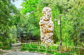 Typical Chinese garden,  park with bizarre rocks. Beijing. — Stock Photo