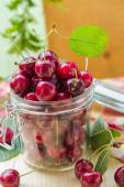 Fresh fruit cherries jar for products processed — Stock Photo