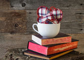 Three Hearts board white mug books — Stock Photo