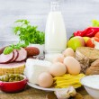 Composition grocery products dairy vegetables fruits meat — Stock Photo #53381623
