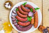 Plate full various species sausages — Stockfoto