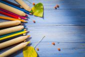 Vintage background colored pencils autumn fruits blue table — Stockfoto