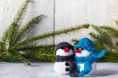 Snowmen board wooden Christmas winter plush duo — Stock Photo