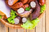 Background basket meat sausages meats — Stock Photo