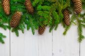 Christmas background spruce twigs cones white wooden — Stock Photo