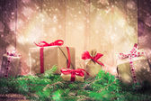 Holidays coming snowing Christmas gifts needles — Stock Photo