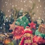 Santa Claus Christmas ornaments green pine needles cones gifts — Stock Photo #58863483