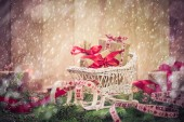Holidays coming snowing Christmas gifts sleigh needles — 图库照片