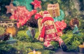 Santa Claus Christmas ornaments green pine needles cones gifts — Stock Photo