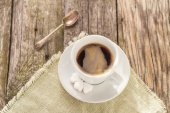 Coffee cup black wooden board brown white — Stock Photo