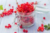Red currant fruit jar wooden table — Stock Photo
