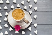 Cup coffee sweets heart shaped lollipop sugar cubes — Stock Photo
