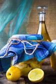 Alcohol jar quince liqueur sliced fruit prepare wooden setting — Stock Photo