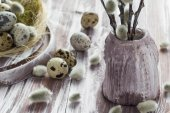 Easter background quail eggs catkins wooden table — Stock Photo