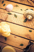Scented candle sea shells wooden background — Stock Photo