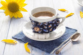Coffee cup black wooden board brown white milk sunflower — Stock Photo