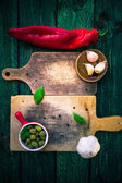 Old chopping boards spices herbs — Stock Photo