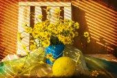 Still life bunch small yellow florets melon — Stock Photo