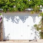 Suburban family house with garage — Stock Photo #64392797